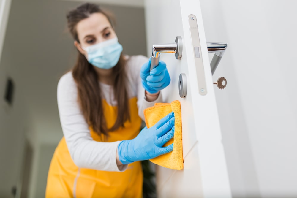 Janitor cleaning office building